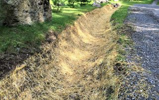 erosion control straw mat installed in a ditch
